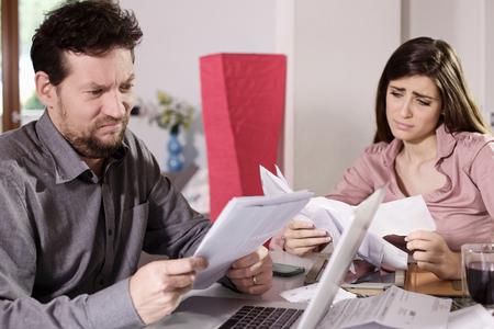 Couple unhappy about taxes Stock Photo