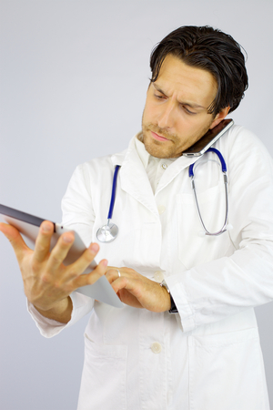 cool doctor working with tablet and phone photo