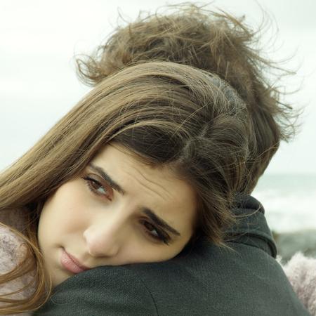 Woman breaking up with boyfriend feeling sad