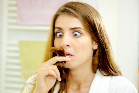 split ends: woman unhappy about split ends hair