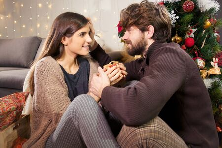 christmas gift: Happy couple in love at christmas night