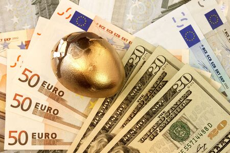 global retirement: Cracked Eggs & Currency: Lost Dreams Stock Photo