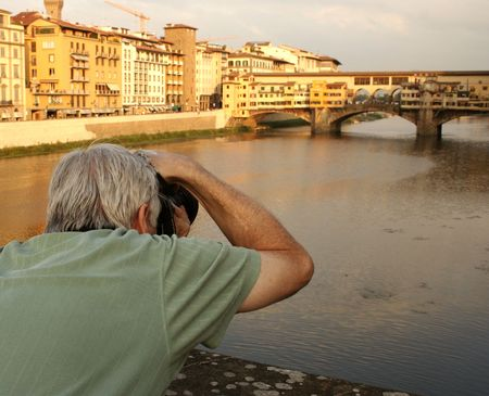 empowerment: 2007, Firenze, Italy, Europe, image of tourist photographing the Ponte Vecchio, capturing a lifetime memory.   Stock Photo