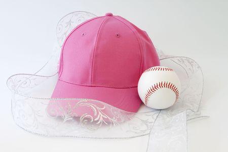 Feminine presentation of a girl's love of baseball; pink cap, white ribbon, and baseball; Stock Photo - 7468095