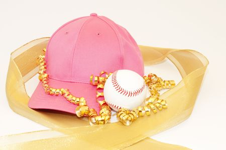 glisten: Girls pink cap, baseball, and the glisten of gold ribbons reflect the gift of sports for girls Stock Photo