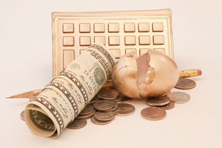 jeopardy: Dollar and change currency next to cracked golden egg with golden calculator and pencil reflect financial jeopardy
