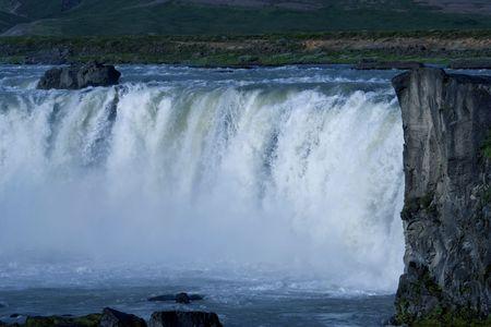 Rushing thunder of Godafoss, Iceland's spectacular waterfall Stock Photo - 7606442