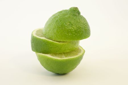 Segments of Reconstructed Green Lime Against White Background