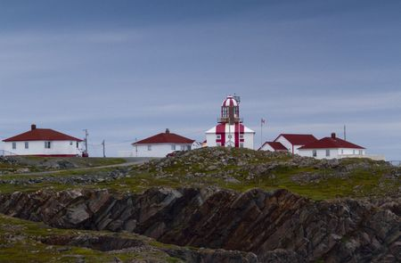 Lighthouse and surrounding red roofed and white buildings at Cape Bonavista, Newfoundland and Labrador, Canada, part of Landfall Municipal Park; Stock Photo