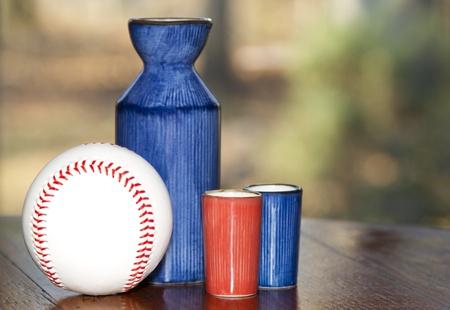 saki: Saki server with two saki glasses and baseball Stock Photo