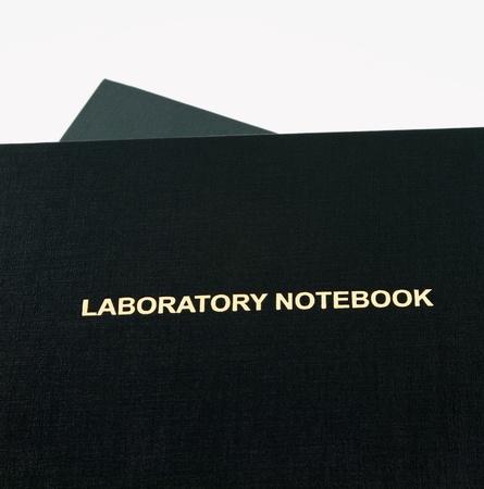 Laboratory notebook titled in gold lettering ; Banco de Imagens