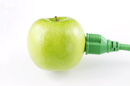 Fresh, green apple with green electric plug and cord attached signify a modern, current emphasis on green energy; Stock fotó