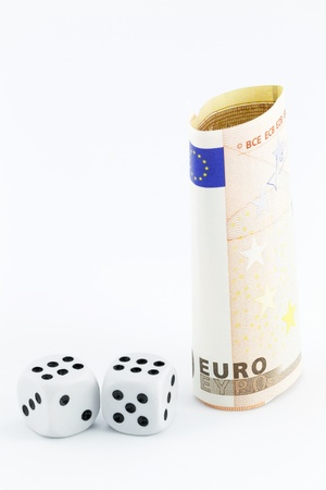 milestones: Euro currency and dice with a white background reflects instability and economic risk