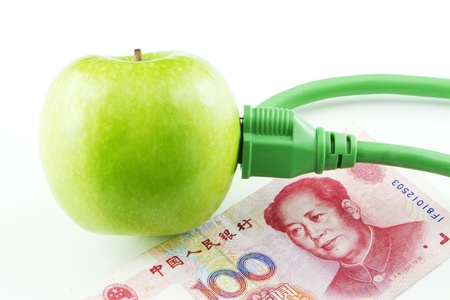Green apple placed next to Chinese yuan currency emphasize Chinas fresh support of energy innovation 版權商用圖片