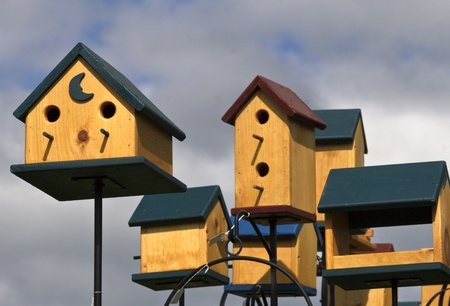Lahaska, PA, USA - April 30, 2011: Local artist crafted bird houses on display at Peddlers Village annual, popular Strawberry Festival Editorial