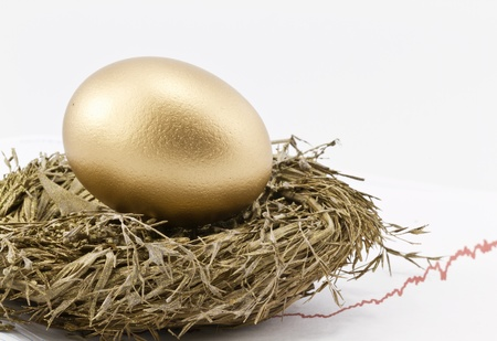 savings goals: Gold nest egg sits in gold nest with rising chart of returns in background and copy space on right