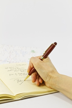 Shallow depth of focus on hand writing in journal