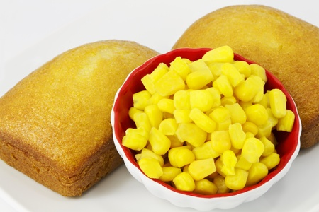 corn meal: Freshly baked corn bread sits with the key ingredient of corn meal -- golden, seasonal corn.