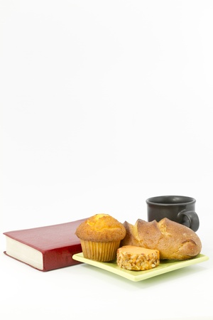 Muffin, bread, cheese, coffee and book in still life; snacktime;