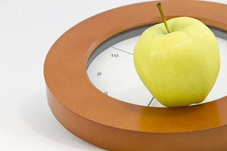 time critical: Apple placed on face of clock indicates that it is time to face school and education issues. Stock Photo
