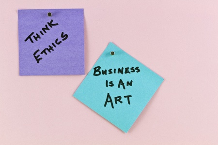 Two notes posted up indicate ethical role underlying good business strategy and analysis.  Philosophical notes read Think ethics and Business is an art.  photo