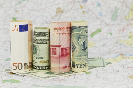 Four, major currencies are placed on a single map, symbolizing their connected financial nature in a global marketplace