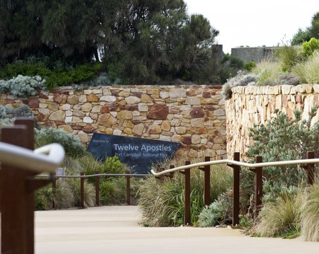 Welcome to Twelve Apostles sign on path to landmark attraction at Visitors Center, Port Campbell National Park, Australia.  This landmark attraction is part of Australia