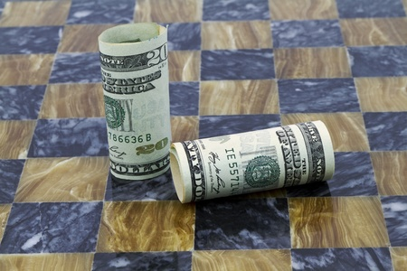 American currency on marble game board