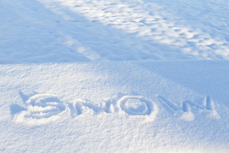 describe: Climate description is traced as fingered letters of snow in new snowfall.