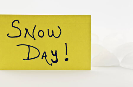 icy conditions: SNOW DAY written on yellow index card and placed in front of ice.