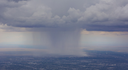 cloudburst: Rain pours onto Albuquerque Airport from clouds over the city.  View as seen from Sandia Crest Highway on scenic byway to peak.