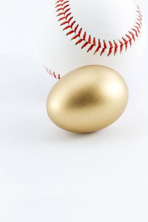 nest egg: Baseball with gold nest egg shows successful business investment Stock Photo