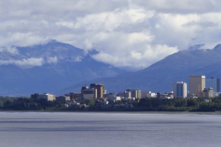 anchorage: Beautiful view of Anchorage skyline across Cook Inlet with rugged Chugach Mountains behind.