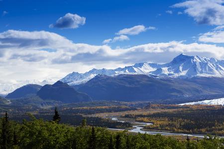 glenn: Majestic Chugach Mountain Range and graceful bends of the Matanuska River as seen from Glenn Highway in Alaska.