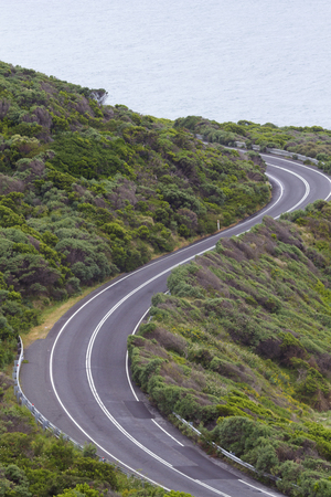 enjoyable: Enjoyable curves of Great Ocean Road in Victoria province of Australia.  Scenic drive along the Surf Coast with its sea views is a popular tourist attraction.  Vertical image with copy space.