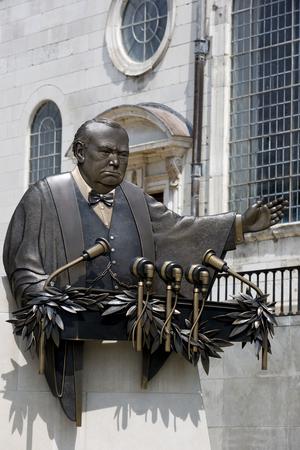 churchill: FULTON, MISSOURI July 1, 2015: Don Wiegand?s bronze sculpture commemorates Winston ChurchillsIron Curtain speech.  Location is outside National Churchill Museum, on the campus of Westminster College, Fulton, Missouri