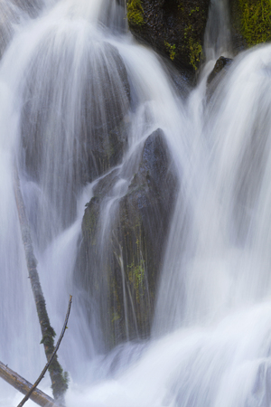 byway: Cascading waterfall over rocks looks like three monks in serene, natural beauty. Location is Clearwater Falls in Oregon on Umpqua Scenic Byway. Stock Photo
