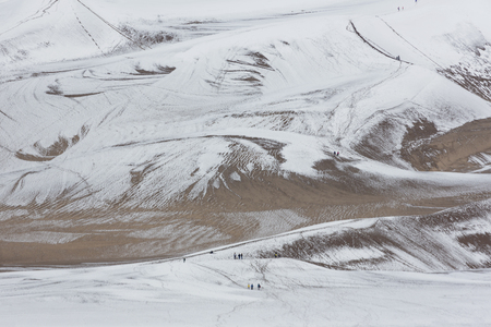 adds: Snow adds to the tourist attraction of the tallest dunes in North America at Great Sand Dunes National Park and Preserve in Colorados San Luis Valley.  Date is May 27, 2016.