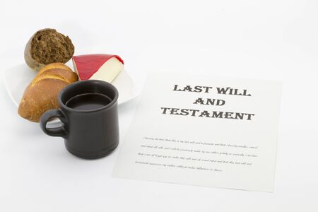 Work on Last Will and Testament next to hot coffee mug, bread, and cheese.  Concept of meeting family responsibilities.  Horizontal photo with copy space. Stock Photo