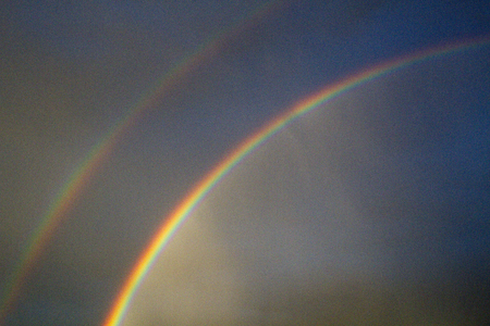 Natural, double rainbow graces a stormy sky in Tucson, Arizona.
