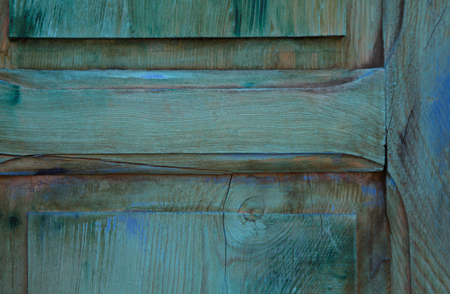 Attractive background of blue hues of wood grain on weathered door.  Location is along Canyon Road in Santa Fe, New Mexico, in Americas Southwest.