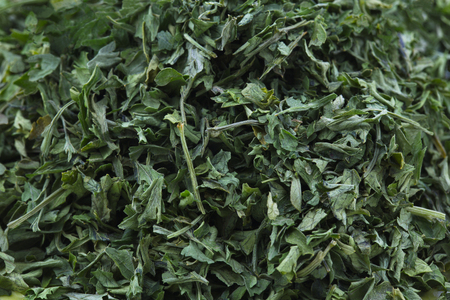flavouring: Close up of dried parsley creates food, spice, and cooking background. Stock Photo