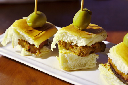 Savory meatloaf sliders with tasty olive accent