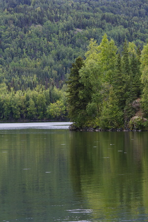 Hidden Lake reflects summer in Alaska at Kenai National Wildlife Refuge. Stock Photo