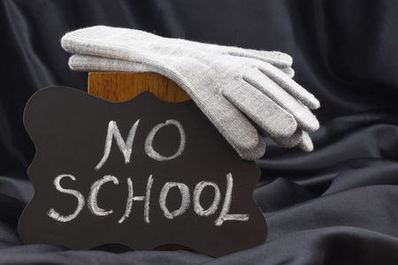 Announcement of NO SCHOOL on chalkboard notifies of winter weather closing.  Фото со стока
