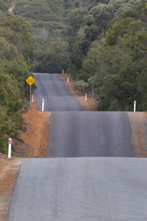 Rolling hills of Torndirrup Road near Big Grove, Western Australia, makes for a fun drive and a challenging run or walk