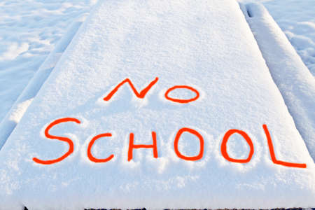 No School carefully printed in fresh snow and enhanced with red interior lettering shows dangerous winter weather is closing schools. Imagens