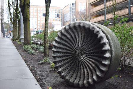 sidewalk cement sculpture