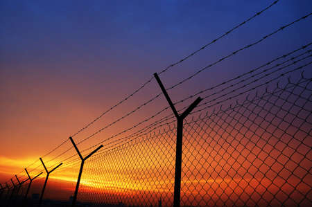 invade: fence Stock Photo