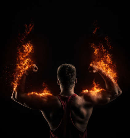 Strong Athletic man on fire Stock Photo